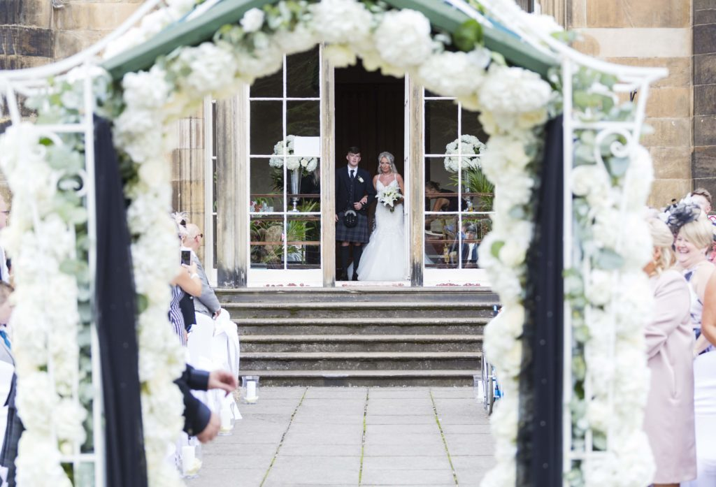 Summer wedding at Marr Hall - wedding flower arch by Nicole Dalby